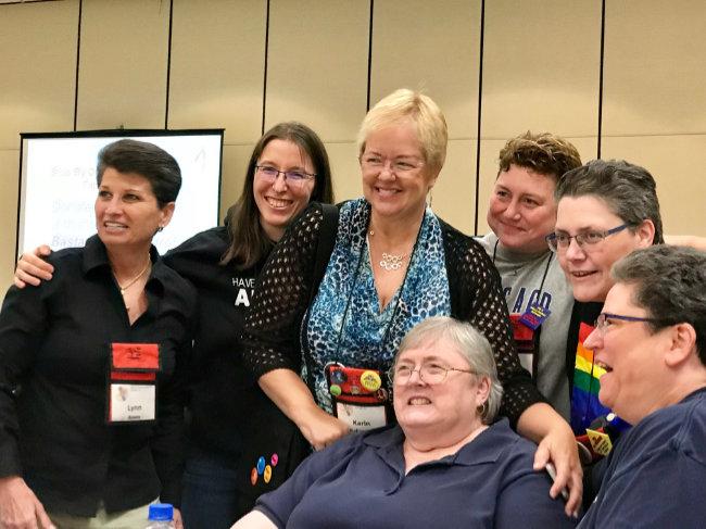 Lynne Pierce surrounded by Lynn Ames, me, Karin Kallmaker, Jessie Chandler, Patty Schramm, Lori Lake